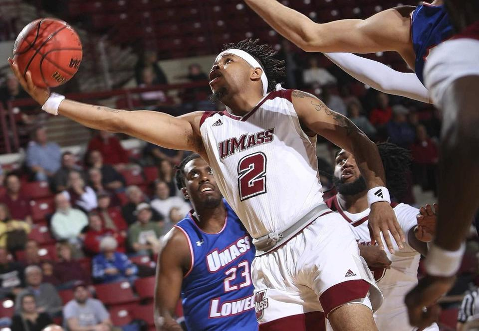 Massachusetts' Luwane Pipkins shoots next to UMass-Lowell's Josh Gantz, right, during the first half of an NCAA college basketball game Tuesday, Nov. 6, 2018, in Amherst, Mass. (J. Anthony Roberts/The Republican via AP)