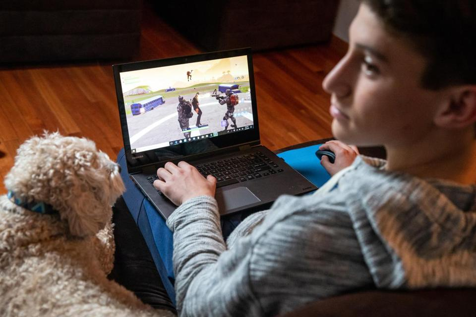Charlie Thibault of Haverhill played 'Fortnite' on his laptop.
