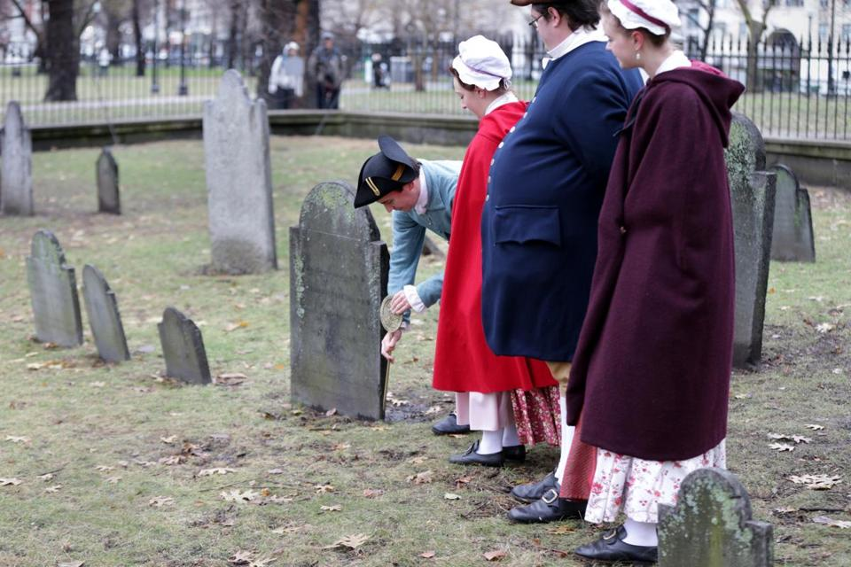 Reenactors from the Boston Tea Party Ships & Museum placed commemorative markers on graves of patriots who participated in the protest.