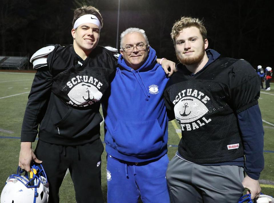 Will Sheskey (left) stands with assistant coach Mark McKeever (center) and Josh McKeever before practice at Scituate High School.