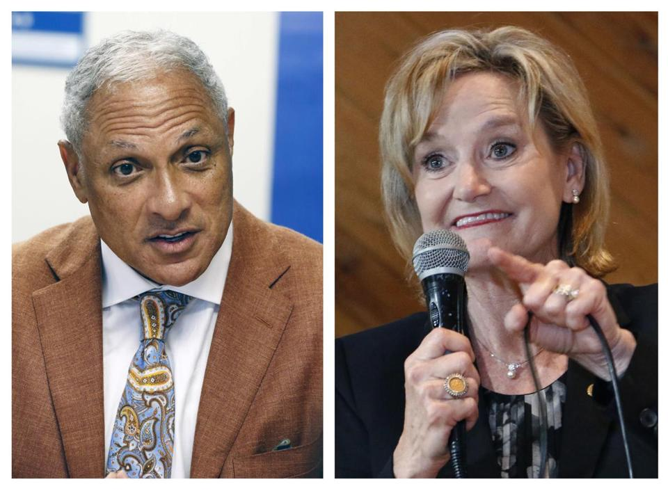 "This combination photo shows Mike Espy, left, a former congressman and former US agriculture secretary, on Oct. 5, 2018, and US Sen. Cindy Hyde-Smith, R-Miss., on Nov. 5, 2018, both in Jackson, Miss. The last US Senate race of the midterms was coming to a close Tuesday, Nov. 27, 2018, as Mississippi residents chose between Hyde-Smith, a white Republican Senate appointee whose ""public hanging"" comments angered many people, and Espy, a black Democrat who was agriculture secretary when Bill Clinton was in the White House. (AP Photo/Rogelio V. Solis, File)"