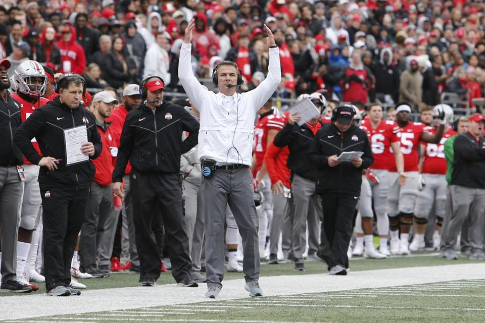 Ohio State head coach Urban Meyer instructs his team against Michigan during an NCAA college football game Saturday, Nov. 24, 2018, in Columbus, Ohio. (AP Photo/Jay LaPrete)