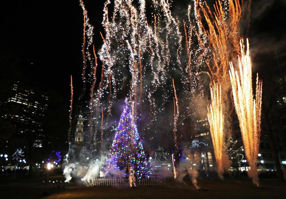 Boston, MA 11-29-18: Fireworks explode around the just lit tree - Thousands Celebrate Tree Lighting On Boston Common, Many For The