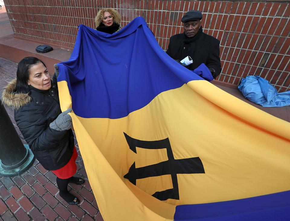 Rollins, the granddaughter of immigrants from Barbados, helped unfurl the Barbados flag during a ceremony last month at City Hall.
