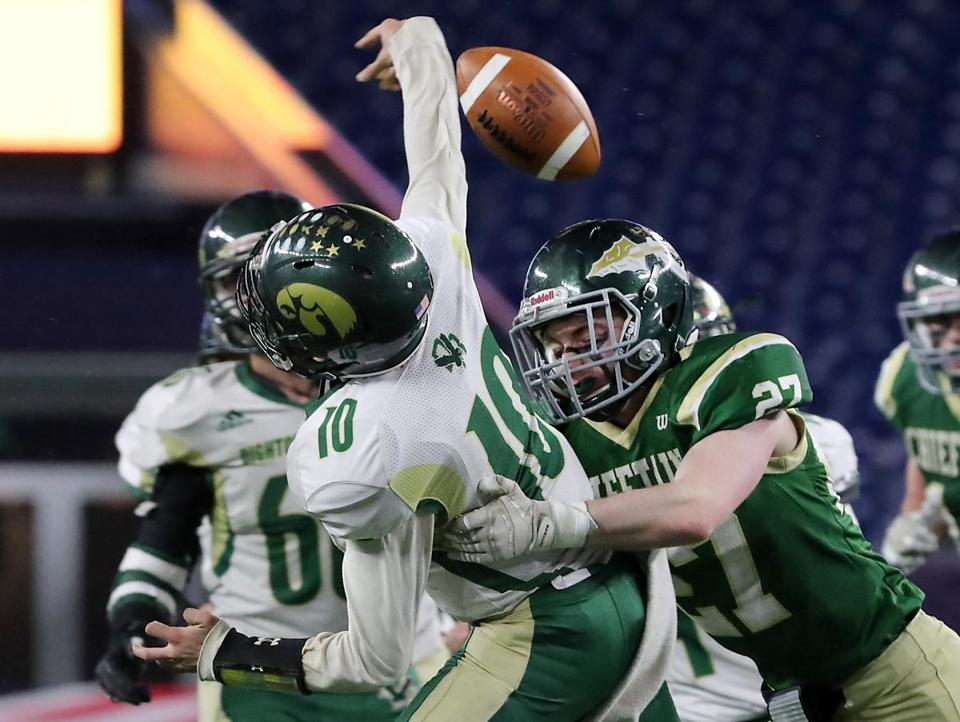 Nashoba Regional's Jack Cahill gets to Dighton-Rehoboth quarterback Harrison Pray during the Division 4 Super Bowl.
