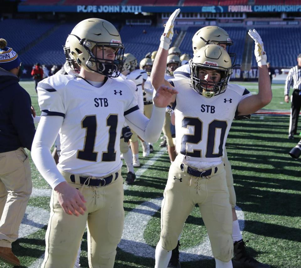 12/01/2018 Foxborough Ma-St Bernard's players #11 Benjamin Shaw (cq) left and #20 Nicholas Mancini (cq) right after their win at the MIAA Division 8 State Championship game aganist Pope John XXIII.Jonathan Wiggs /Globe Staff Reporter:Topic: