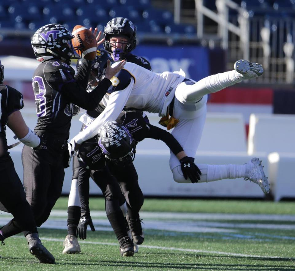 Blackstone Valley Tech's JD Antaya, left, makes an interception in the Division 7 Super Bowl.