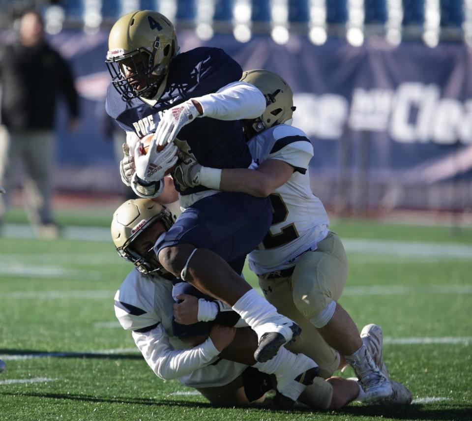 Pope John XXIII's Greg Smith is tackled during the Division 8 Super Bowl against St. Bernard's.