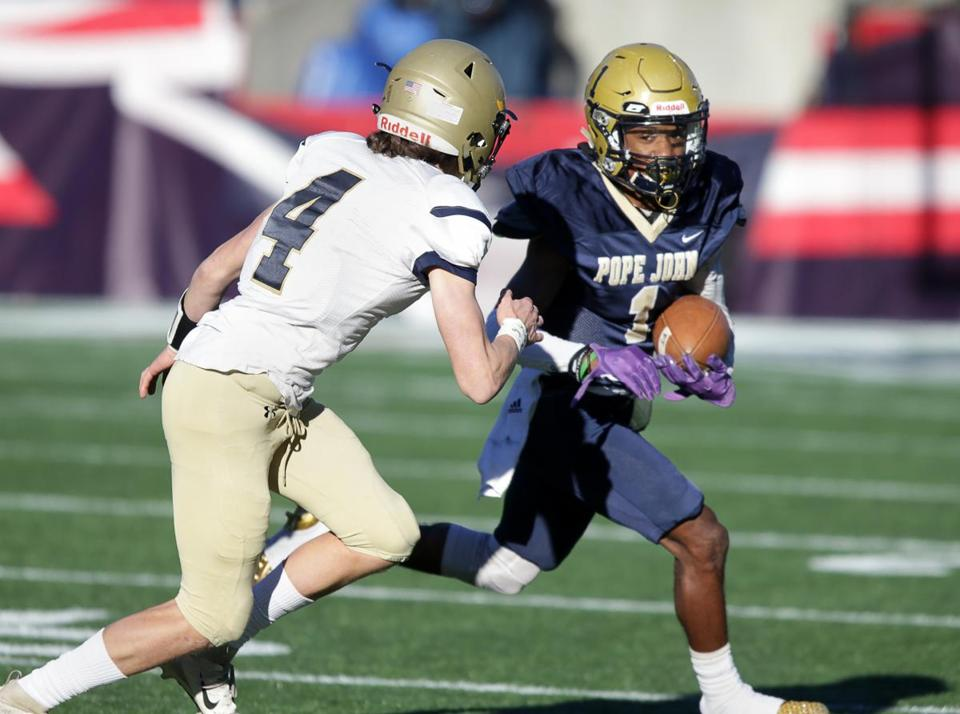 Pope John XXIII's John Smith Howell carries the ball during the MIAA Division 8 Super Bowl against St. Bernard's.