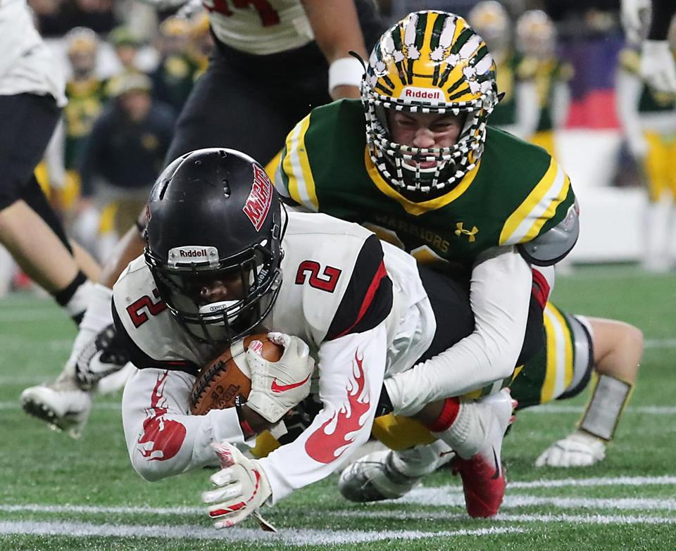 North Andover's Darren Watson is tackled by King Philip's David Morganelli after recovering a fumble in the Division 2 Super Bowl.
