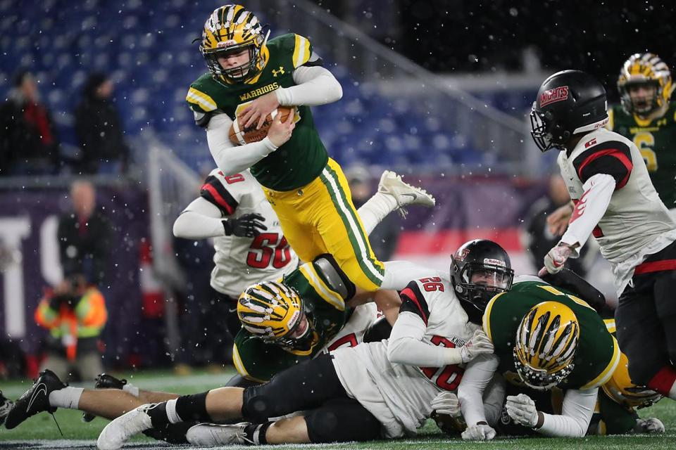 King Philip running back Ryan Halliday leaps over the pile in the Division 2 Super Bowl against North Andover.