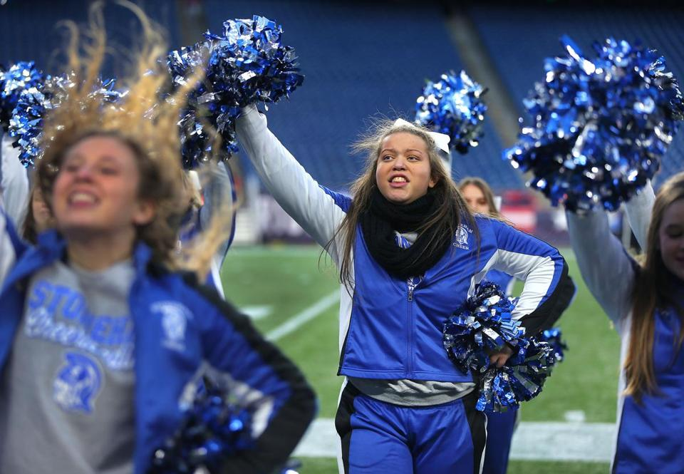 Stoneham High cheerleader Autumn Bardell performs with her teammates at Gillette Stadium as her team played Old Rochester in the Division 6 Super Bowl.