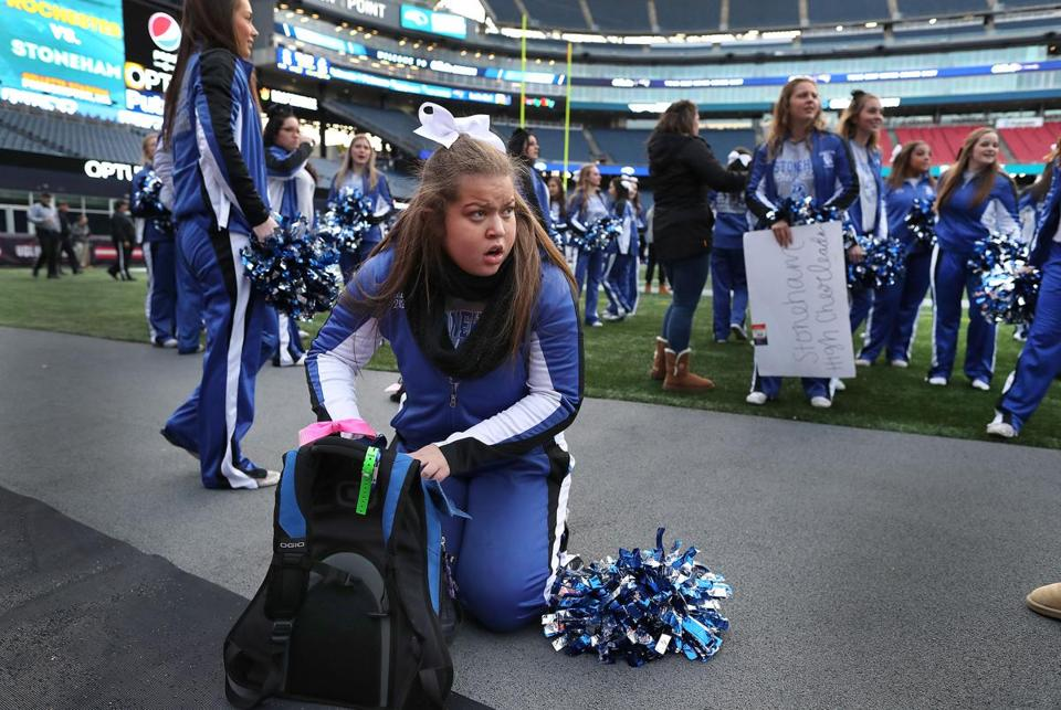 Stoneham High cheerleader Autumn Bardell gets her gear together at Gillette Stadium as her team played Old Rochester in the Division 6 Super Bowl.