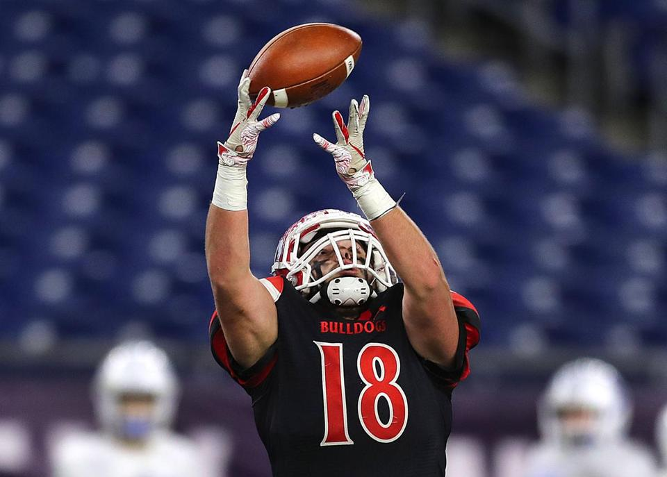 Old Rochester's Adam Breault catches a pass in the Division 6 Super Bowl against Stoneham.