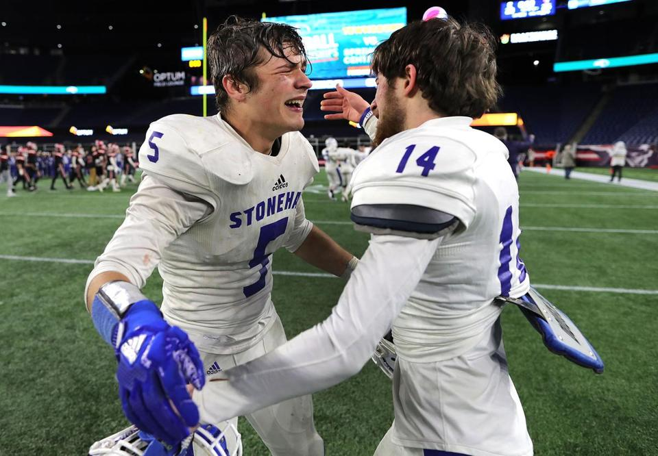 Nicholas Brulport (left) and Dante Messina celebrate Stoneham's victory in the Division 6 Super Bowl.