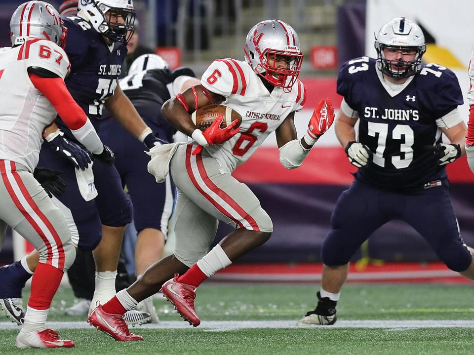 Catholic Memorial's Devon Williams returns a recovered fumble 47 yards for a TD in the second quarter.