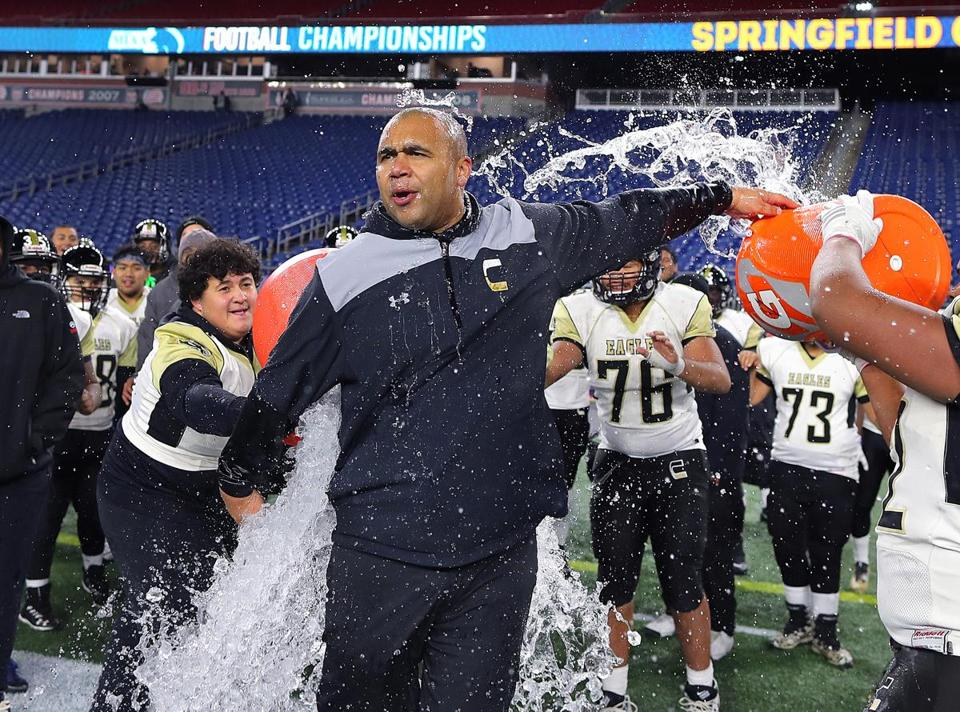 Springfield Central coach Valdamar T. Brower gets a celebratory dousing of water after his team defeated Tewksbury to win the Division 3 Super Bowl.
