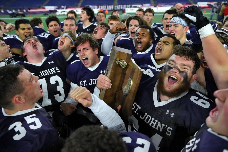 St. John's Prep celebrates defeating Catholic Memorial to win the Division 1 Super Bowl at Gillette Stadium.