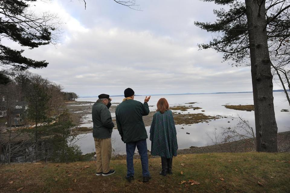 Northport, ME - 12/01/2018 From left, Maine residents, Sid Block of Northport, Dave Losee of Camden, and Kim Ervin Tucker of Lincolnville look at the area where they are concerned about a massive amount of polluted water that could be discharged into MaineÕs Penobscot Bay. The pollution is a concern if the world's largest indoor salmon aquafarm is built near this location by a Norwegian company. Fred J. Field for the Boston Globe Story by David Abel