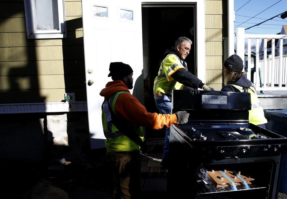 Lawrence, MA, 12/3/2018 -- Workers deliver a new stove to a home in South Lawrence. (Jessica Rinaldi/Globe Staff) Topic: 04lawrence Reporter: