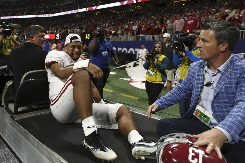 A dejected Tua Tagovailoa is carted off the field after hurting his ankle during Alabama's SEC title victory.