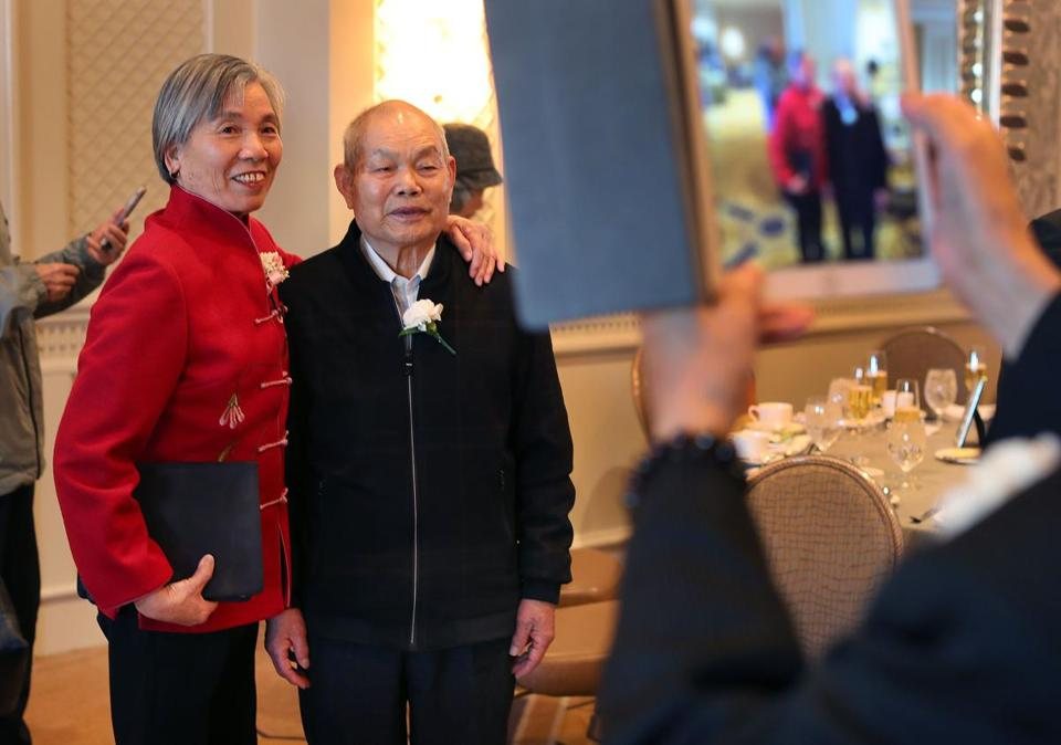 Boston-12/4/18 Ginsong Shu(left) and her husband Quixuang Wang, married 51 years, have their photo taken by a friend at their table. The annual Golden Wedding Anniversary Celebration was held at the Four Seasons Hotel in Boston for Boston Couples married fifty years or longer. It was the 40 year for the event. Photo by John Tlumacki/Globe Staff(metro)