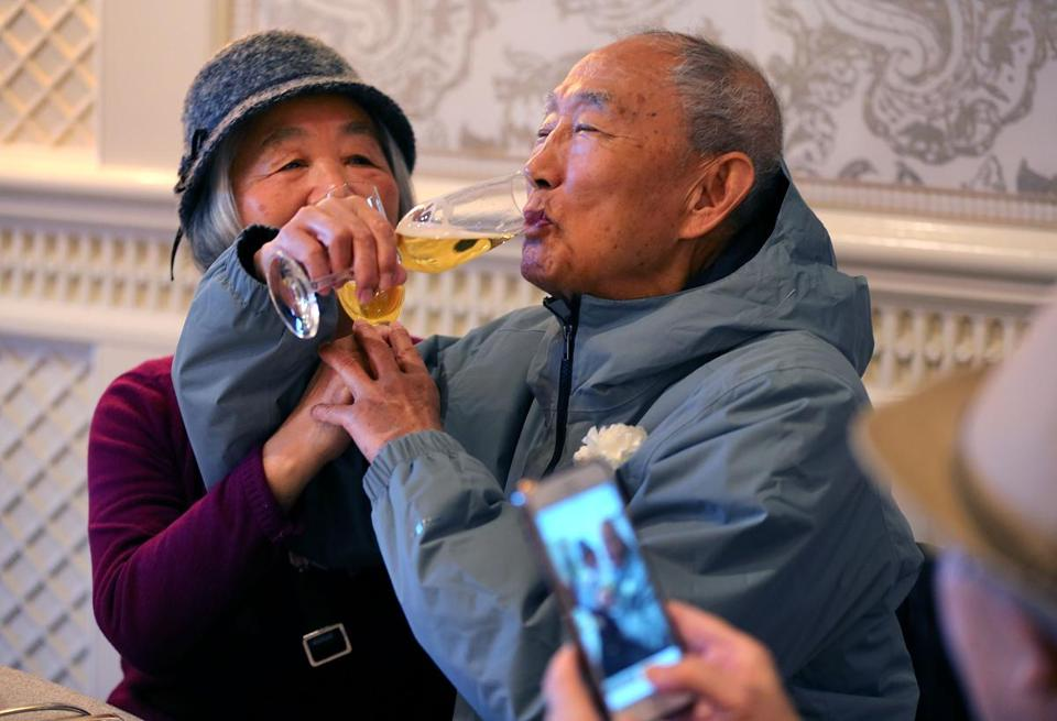 Boston-12/4/18 Jian Guan(left) and her huband of 58 years, Shi, interlock their arms as they toast one another at the annual Golden Wedding Anniversary Celebrationheld at the Four Seasons Hotel in Boston for Boston Couples married fifty years or longer. It was the 40 year for the event. Photo by John Tlumacki/Globe Staff(metro)