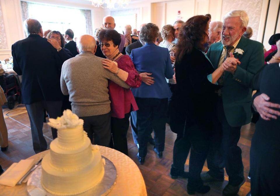 Boston-12/4/18 The annual Golden Wedding Anniversary Celebration was held at the Four Seasons Hotel in Boston for Boston Couples married fifty years or longer. It was the 40 year for the event. Couple dance nearthe anniversary cake. Photo by John Tlumacki/Globe Staff(metro)