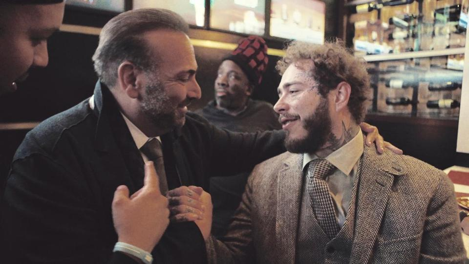 06namesmalone - Post Malone chats with Strega owner Nick Varano at Strega Waterfront on Tuesday. (The Varano Group)