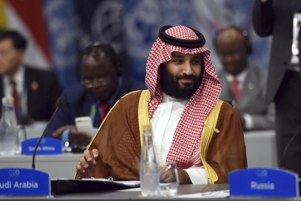 FILE - In this Dec. 1, 2018, file, photo released by the press office of the G20 Summit Saudi Arabia's Crown Prince Mohammed bin Salman attends a plenary session on the second day of the G20 Leader's Summit in Buenos Aires, Argentina. Turkey is seeking the arrest of two former aides to Saudi Crown Prince Mohammed bin Salman who were dismissed amid the fallout from the killing of Washington Post columnist Jamal Khashoggi.(G20 Press Office via AP, File)