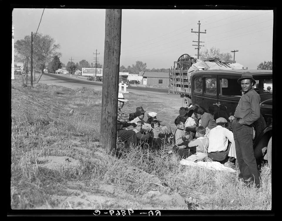 Mexicans bound for the Imperial Valley to harvest peas. Near Bakersfield, California, November 1936. Public domain