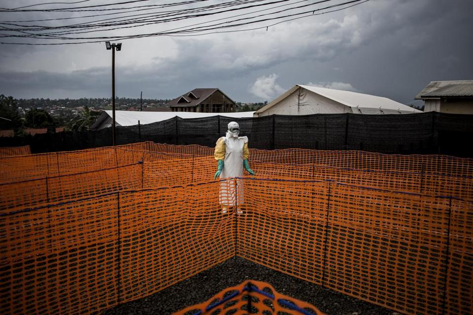 In this photo taken Wednesday, Nov. 7, 2018 and made available Tuesday, Dec. 4, 2018, a health worker waits to receive a new unconfirmed Ebola patient at a Medecins Sans Frontieres (MSF) supported Ebola treatment centre in Bunia, Congo. Congo's deadly Ebola outbreak is now the second largest in history, behind the devastating West Africa outbreak that killed thousands a few years ago, according to the World Health Organization. (John Wessels/Medecins Sans Frontieres via AP)