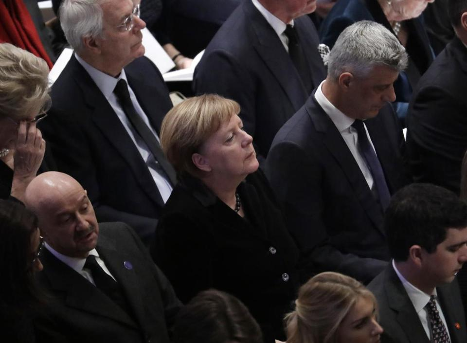 German Chancellor Angela Merkel is shown seated during a State Funeral for former President George H.W. Bush at the National Cathedral, Wednesday, Dec. 5, 2018, in Washington. (AP Photo/Evan Vucci)