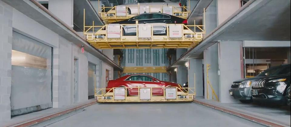 Automated garages, which can tightly stack cars, are coming to two Boston developments.