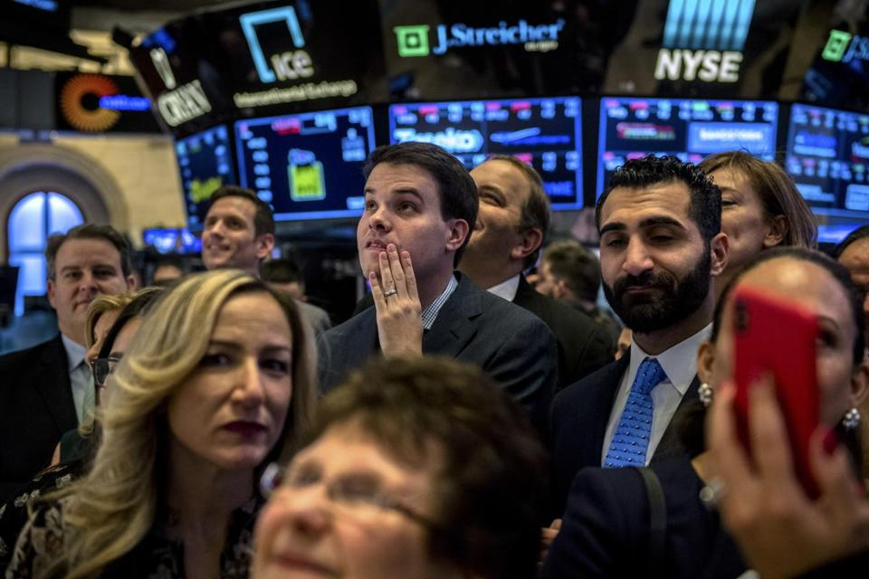 People on the floor of the New York Stock Exchange moments before the closing bell, Nov. 20, 2018. The stock market's gains for 2018 were erased on Tuesday, as a sell-off led by giant technology stocks continued. The renewed declines in the United States came after drops in Asia and Europe. (Hilary Swift/The New York Times)