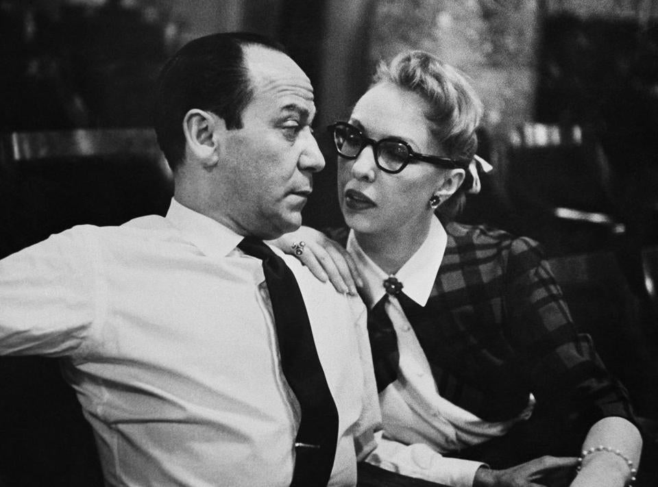 "Broadway composer Frank Loesser and his wife and musical partner Lynn are shown, April 26, 1956 in New York. Their song ""Baby, It's Cold Outside"" was originally a song they performed for friends at their housewarming party. (AP Photo/Anthony Camerano)"