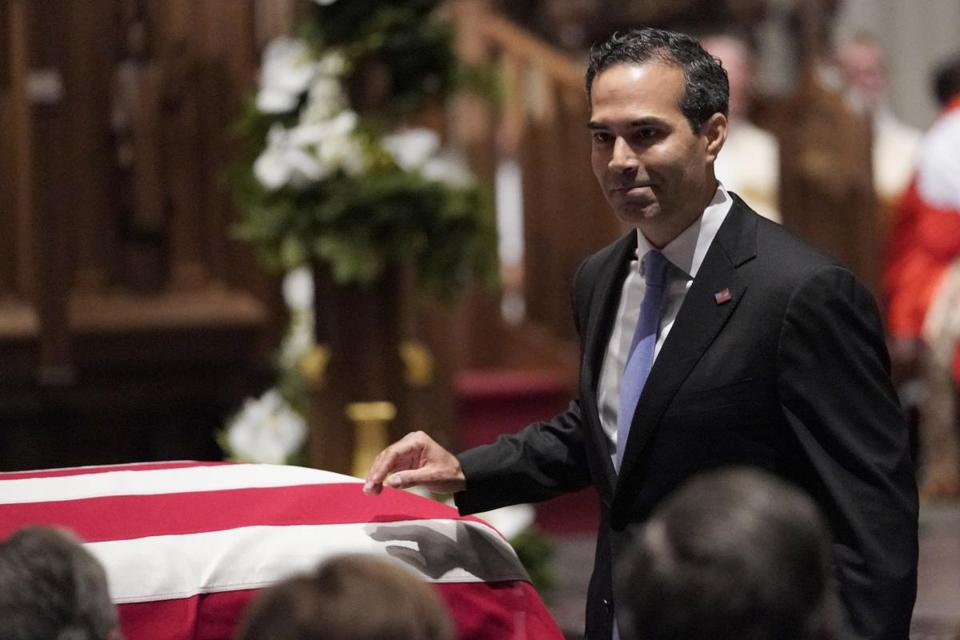 HOUSTON, TX - DECEMBER 06: (AFP-OUT) George P. Bush walks past the casket of former President George H.W. Bush after giving a eulogy at St. Martin's Episcopal Church, on December 6, 2018 in Houston, Texas. President Bush will be buried at his final resting place at the George H.W. Bush Presidential Library at Texas A&M University in College Station, Texas. A WWII combat veteran, Bush served as a member of Congress from Texas, ambassador to the United Nations, director of the CIA, vice president and 41st president of the United States. (Photo by David J. Phillip-Pool/Getty Images)