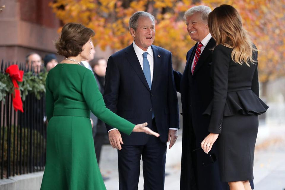 WASHINGTON, DC - DECEMBER 04: (AFP OUT) Former first lady Laura Bush and former President George W. Bush greet President Donald Trump and first lady Melania Trump outside of Blair House December 04, 2018 in Washington, DC. The Trumps were paying a condolence visit to the Bush family who are in Washington for former President George H.W. Bushs state funeral and related honors. (Photo by Chip Somodevilla/Getty Images) *** BESTPIX ***