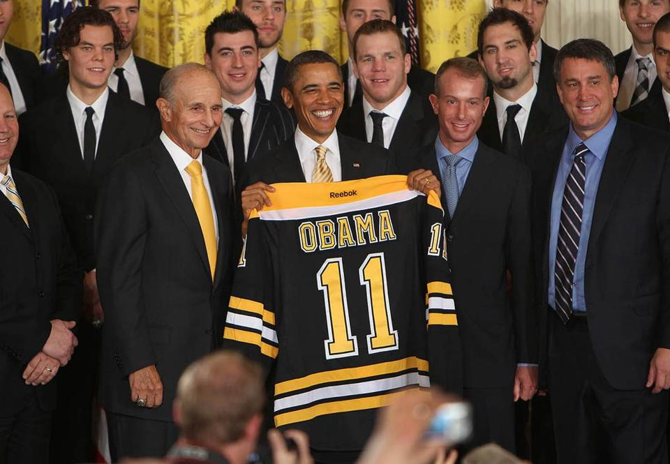 Washington D.C. -01/23/12 - President Obama greeted the Boston Bruins as they visited the White House. Obama was presented with a team jersey after he spoke in the East Room. Bruins owner Jeremy Jacobs stands next to Obama's right along with coach Claude Julien. Boston Globe staff photo by John Tlumacki (sports)