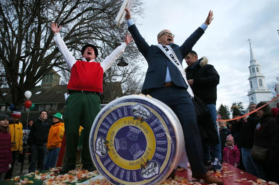 "Peter Lovis (left), owner of The Cheese Shop, and ""town crier"" Steve Ng celebrated the arrival of the 400-pound cheese wheel."