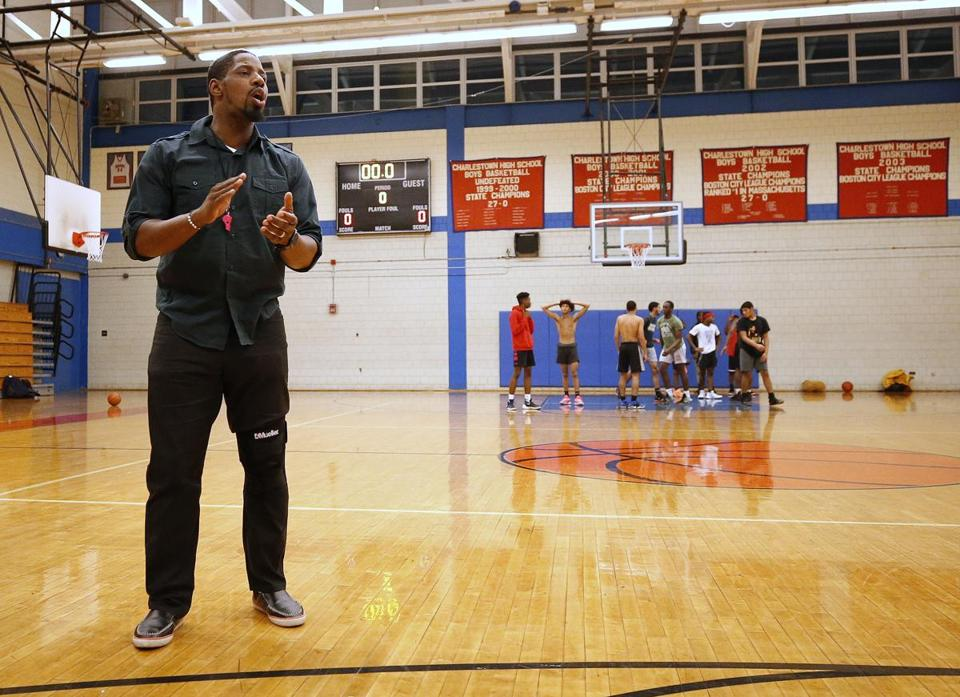 With state championship banners hanging on the wall of Charlestown High's gym,  first-year coach Hugh Coleman hopes to rekindle that championship culture at his alma mater.
