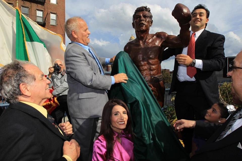 Tony DeMarco, far left, looked on as a statue honoring him was unveiled in 2012.