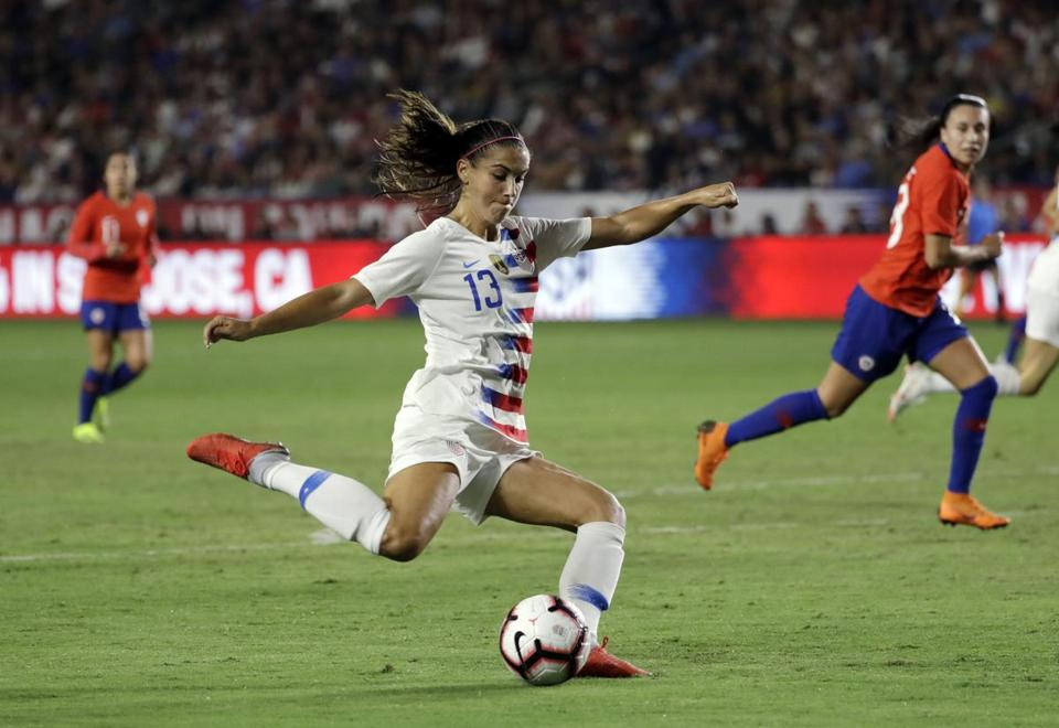 FILE - In this Aug. 31, 2018, file photo, United States' Alex Morgan takes a shot on goal against Chile during the first half of an international friendly soccer match, in Carson, Calif. Morgan, who had 18 goals in 19 games this year to lead the national team, has been named U.S. Soccer's Player of the Year.(AP Photo/Marcio Jose Sanchez, File)