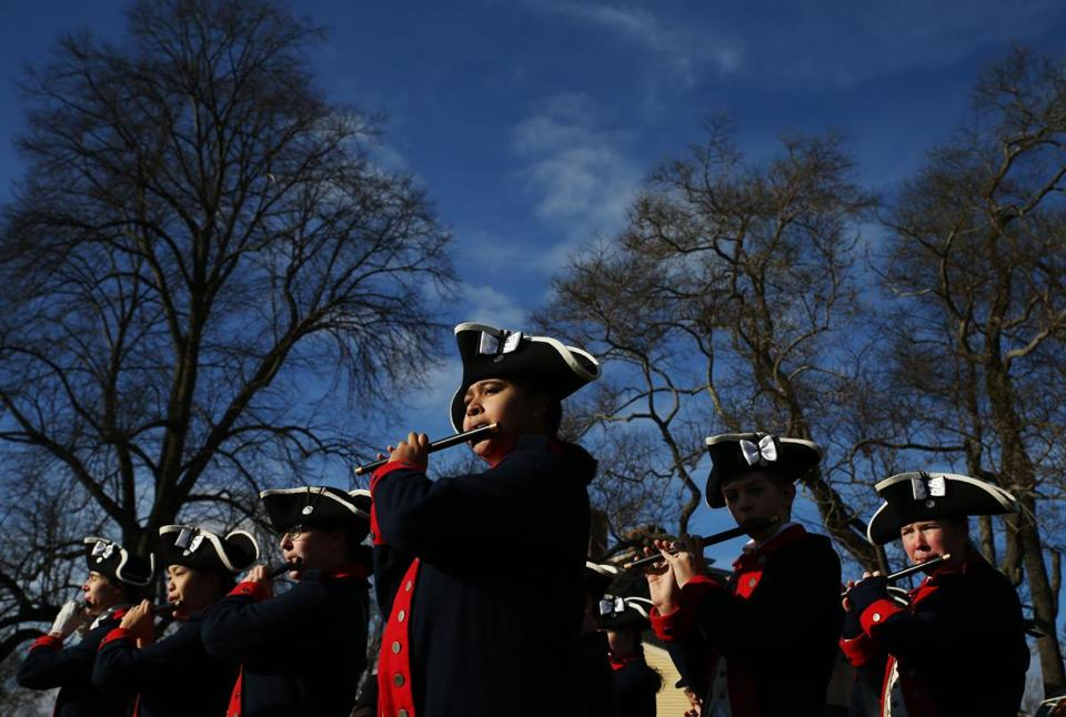 Joanna Suber, 17, of Lexington, played the fife in the William Diamond Jr. Fife and Drum Corps as a part of the tea burning event.