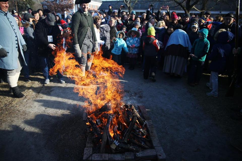 Spectators were encouraged to throw tea into the fire.