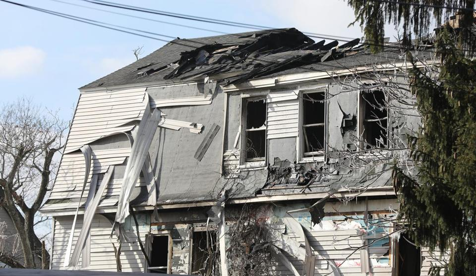 Eight residents were displaced during Sunday morning's five-alarm fire on Lowell Street in Worcester. Firefighter Christopher Roy died while battling the blaze. (Pat Greenhouse/Globe Staff)