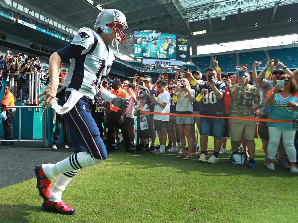 Fans cheered as Tom Brady took the field for pregame warmups.