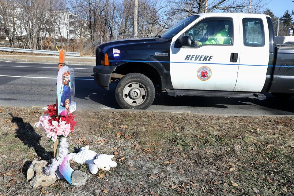 This Revere vehicle stopped briefly in the left travel lane to allow a woman to place the stuffed animal at the scene.