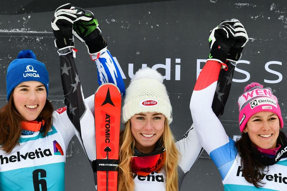 Winner US Mikaela Shiffrin (C) celebrates with second-placed Slovakia's Petra Vlhova (L) and third-placed Switzerland's Wendy Holdener (R) on the podium after competing in the Women's Parallel Slalom race during the FIS Alpine Ski World Cup on December 8, 2018, in Saint Moritz. (Photo by Fabrice COFFRINI / AFP)FABRICE COFFRINI/AFP/Getty Images