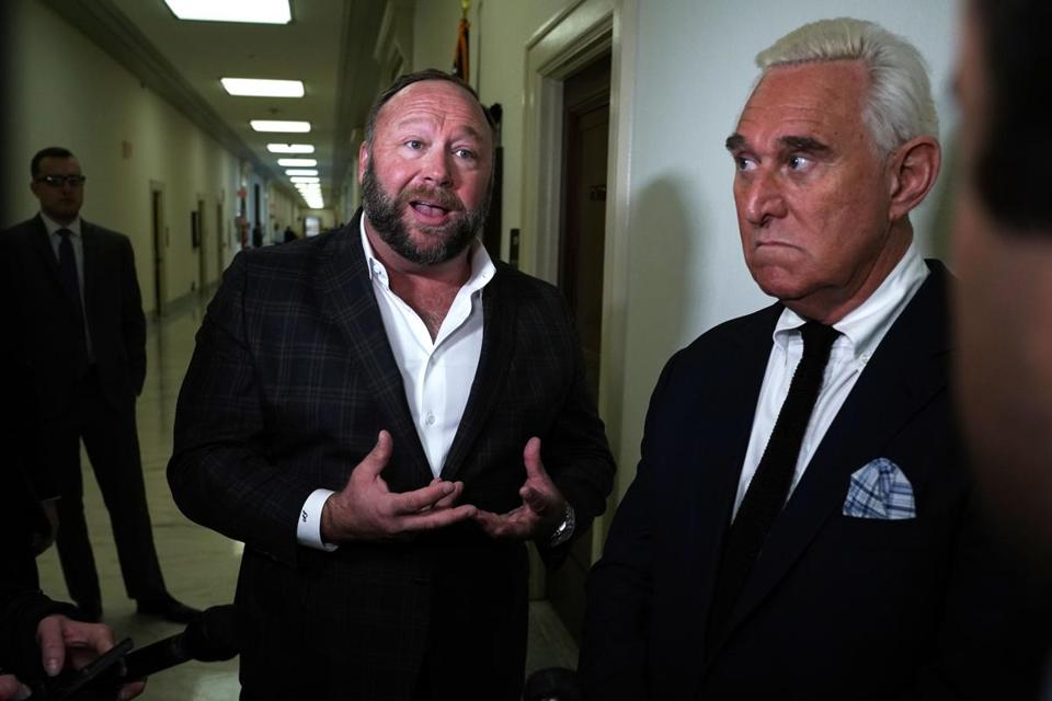 Alex Jones (left) and Roger Stone spoke outside of Tuesday's hearing.